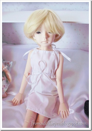 New male doll with a new wig and a dress?