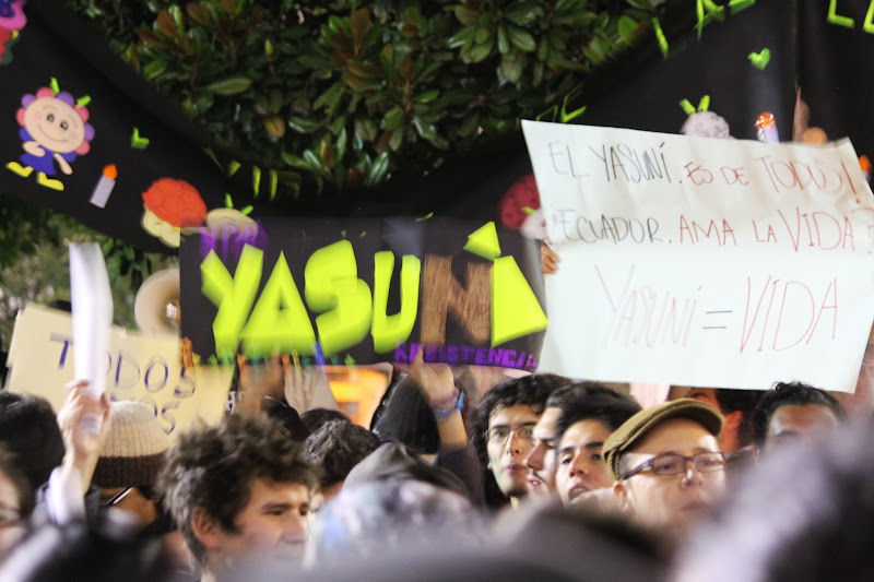 Supporters in favor of keeping the ITT oil fields beneath Yasuni National Park permanently in the ground protest outside Ecuador's presidential palace.