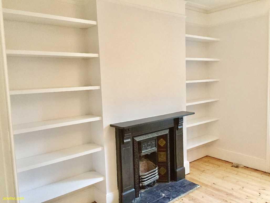 white floating bookshelves