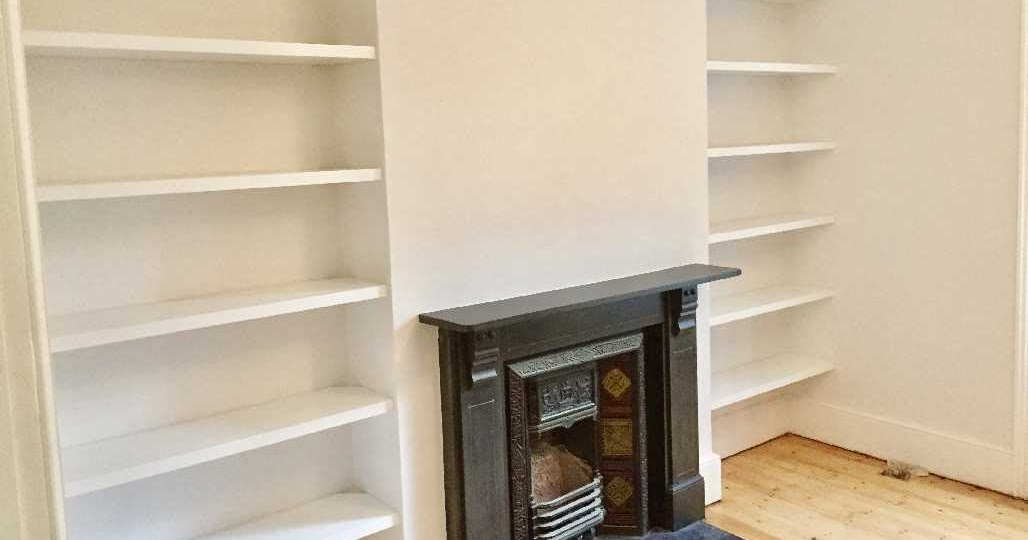 white floating bookshelves
