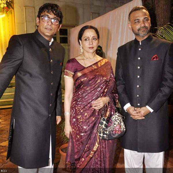(L-R) Ajinkya Deo, Hema Malini and Abhinay Deo at Ramesh and Seema Deo's 50th wedding anniversary, held at ISKCON, in Mumbai, on July 1, 2013. (Pic: Viral Bhayani)
