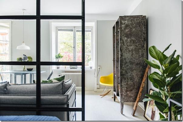 monolocale-parete-vetrata-soluzione-salva-spazio-4