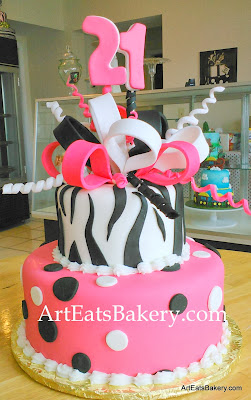 Two tier animal print lady's 21st birthday  pink and black zebra and polka dot with edible bow and topper