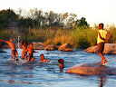 As you can maybe see (and will see further), playing in the river is one of the favorite things for the kids to do.