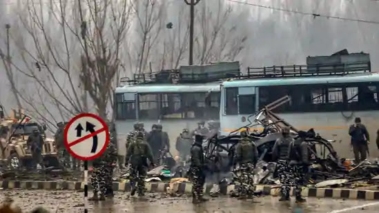 security personnel are seen carrying out the rescue and relief works at the site of suicide bomb attack at Lathepora, Awantipora in Pulwama
