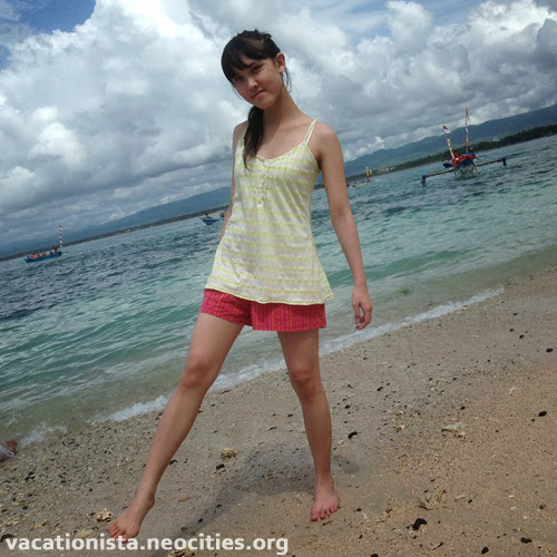 Gorgeous Alexia, stand in the white sand two