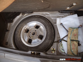 Full Size spare alloy with original 1980s Toyota toolkit