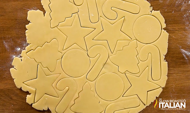 cutting out christmas sugar cookies