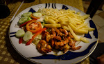 ajillo de camarones - prawns fried in garlic and oil with chips, colslaw and salad