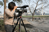 An Affp volunteer videos the pollution caused by the paper mill