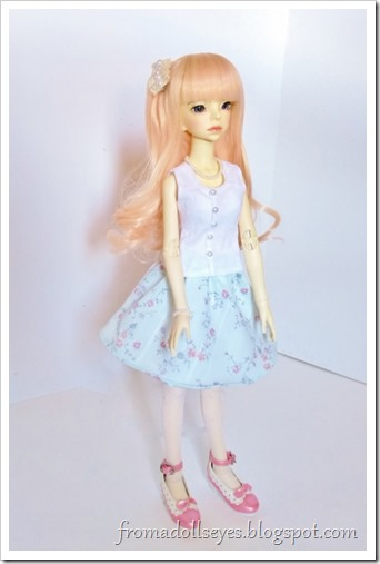 A msd sized ball jointed doll (Misako) wearing her new outfit.  A button down tank top, floral print half circle skirt, pearl necklace with matching bracelet, and large lacy hair barrette.  She also is wearing her shoes and tights from before.