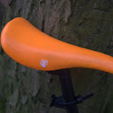 Orange 'Fly' saddle from BrickLaneBikes. Kind of regretting this now because it's already starting to get dirty.