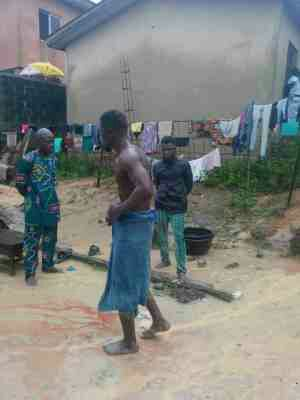 PHOTOS: Armed Robber Caught, Stripped And Beaten To Pulp In Ikorodu