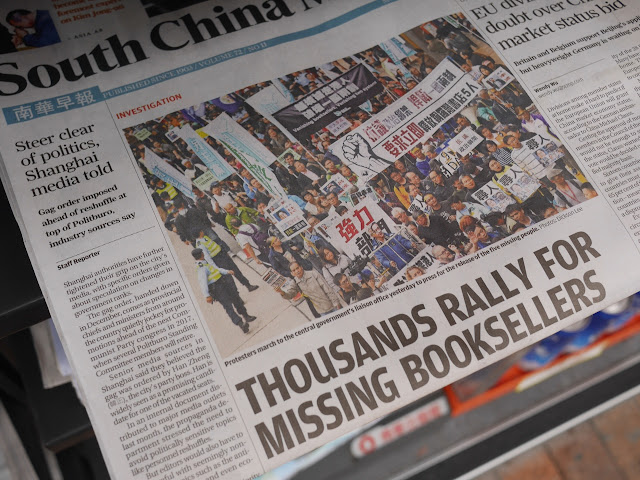 "Front page of South China Morning Post with headlines ""Steer clear of politics, Shanghai media told"" and ""Thousands Rally For Missing Booksellers"""