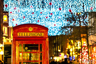 Photo: Red Phone Box and Christmas Lights in Covent Garden - London, England.  The red telephone box was designed by Sir Giles Gilbert Scott. It is a familiar sight on the streets of the UK and despite a reduction in their numbers in recent years, red boxes can still be seen in many places and current or ex-British Colonies around the world. The color red was chosen to make them easy to spot. The red phone box with its crown insignia, domed roof and the helpful name TELEPHONE across all four sides will never be surpassed as a design icon.  #CoventGarden   #Christmas   #London   #England   #UK   #GreatBritain   #Travel   #Photography   © Yen Baet - www.YenBaet.com. All Rights Reserved. Join me on Facebook at www.facebook.com/YenBaetPhotography.