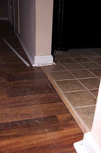 New hardwood floor meets almost new tile floor.