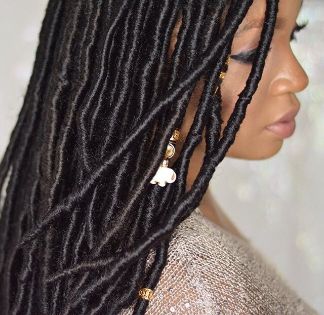 lingywashere with black locs and gold beads