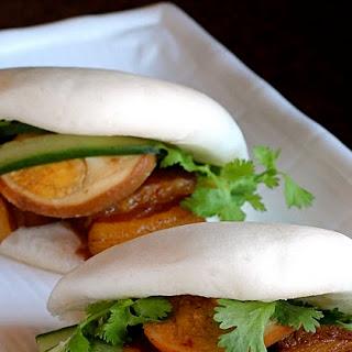 Vietnamese braised pork belly and hard boiled eggs in coconut juice (Thit Heo Kho Trung). Momofuku inspired steamed pork buns