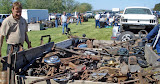 Car parts, repair tips and tall tales all exchanged at auto swap meet