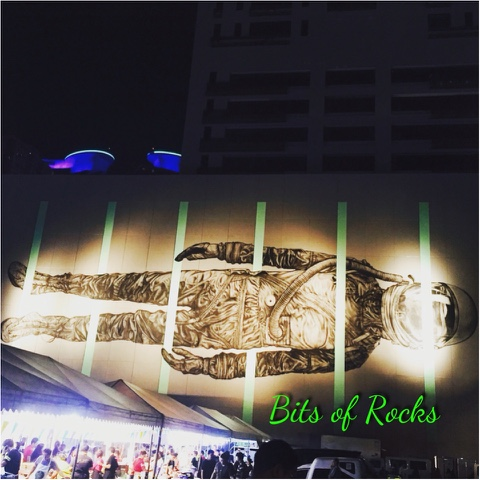 A work of art in the bgc wall bits of rocks for Bonifacio mural painting