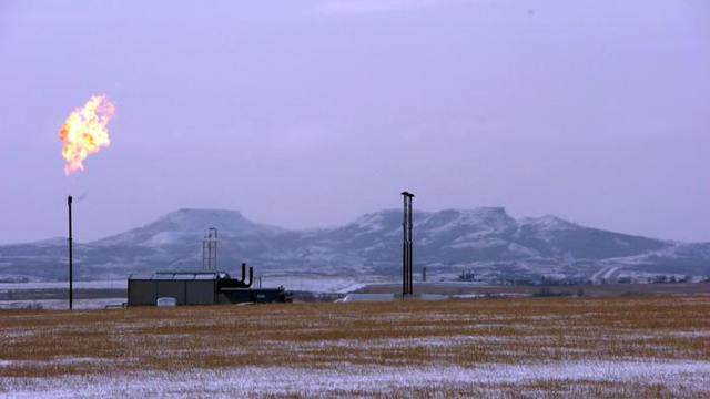 A gas flare at a natural gas processing facility near Williston, North Dakota. Photo: Matthew Brown / Associated Press