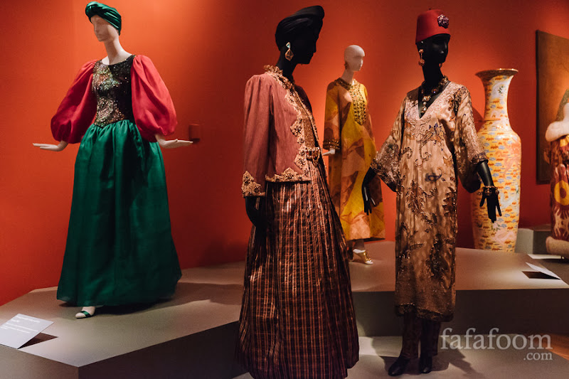 (Left to right) Oscar de la Renta, Evening ensemble: bodice and skirt, Spring 1982. Evening ensemble: jacket, top, and skirt, Fall 1981. Caftan, Fall 1967. Evening ensemble: tunic and pants, Fall 1982.