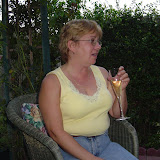 Cindy enjoys the wine and company.