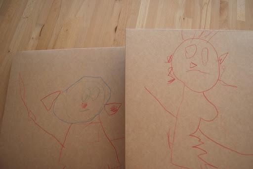 Kan ik niet al goed mannetjes tekenen? Links opa, rechts oma.