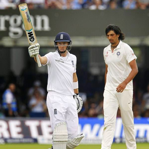 England's Joe Root (L) celebrates reaching 50 runs not as India's Ishant Sharma (R) reacts on the fifth day of the second cricket Test match between England and India at Lord's cricket ground in London on July 21, 2014.