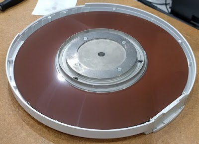 Opening a disk cartridge reveals the single hard disk platter. The disk isn't scratched; it's just the lighting.