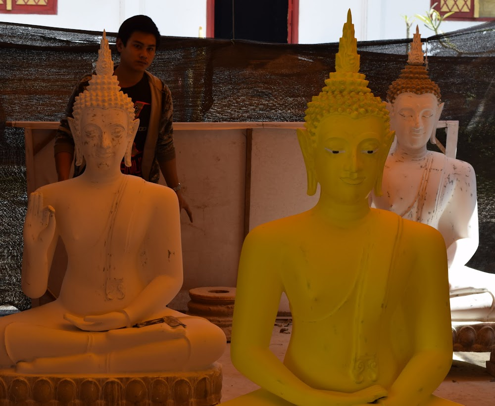 This student is making Buddha statues...