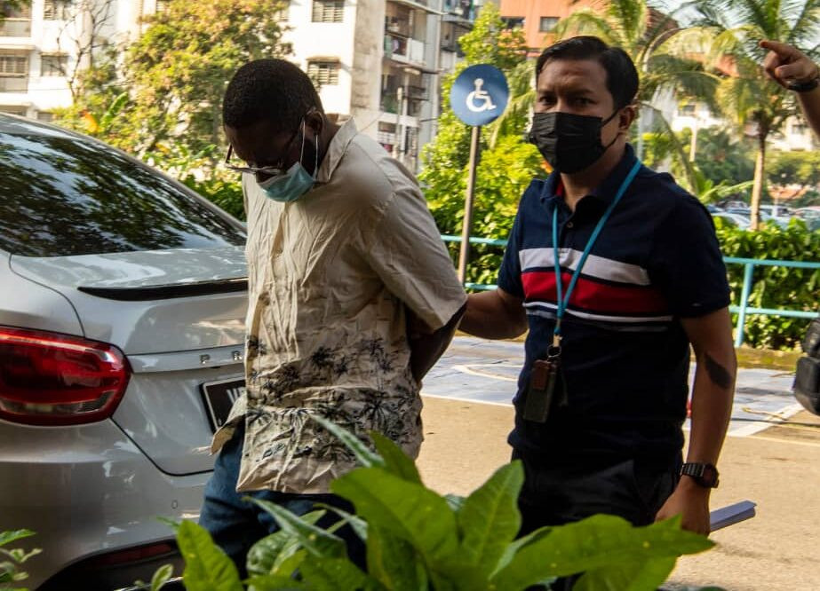 A man and his Malaysian wife charged with illegal transfer of money belonging to another person in Kula Lumpur