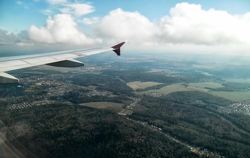 Aboard a half-empty Aeroflot airplane, approaching Moscow... gulp!