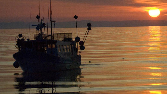 An illegal fishing boat at sunset in Saint-Raphaël, France. Overfishing, bottom trawling, and pollution haunt the Mediterranean Sea. Photo: Carlos Suárez / OCEANA