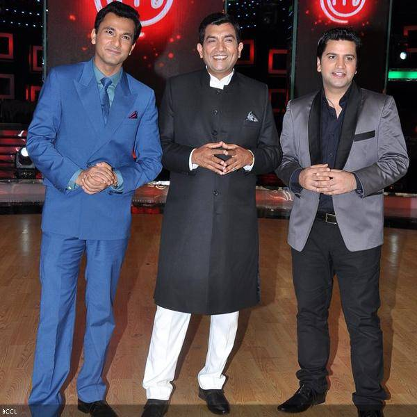 (L-R) Judeges, Vikas Khanna, Sanjeev Kapoor and Kunal Kapoor seen in an identical pose during the grand finale of the cookery show Master Chef Season 3, held in Mumbai. (Pic: Viral Bhayani)<br />