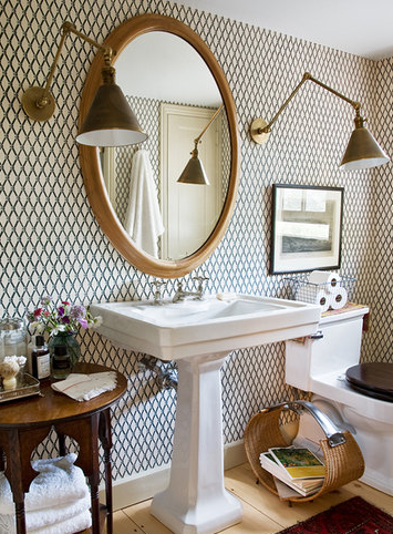 Mirror and vintage sconces the wood floor and table add rustic charm