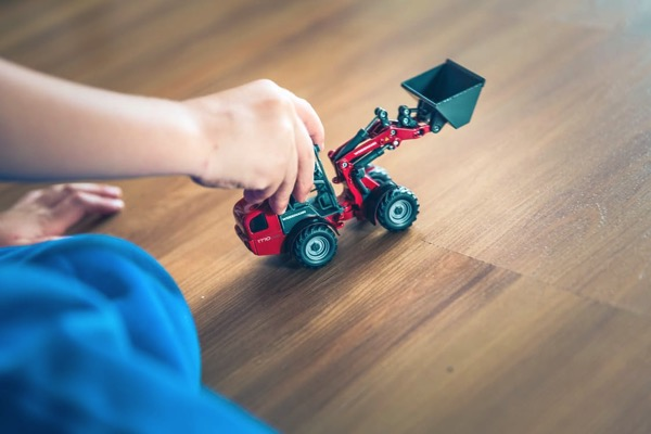 Playing with truck on hardwood floors