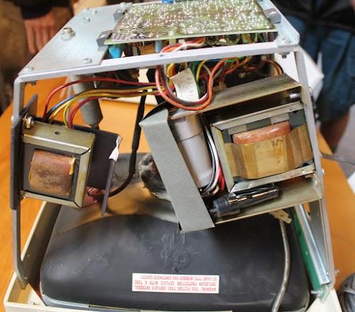 Inside the Alto's monitor. The screen is at the bottom. The power supply transformer is on the right and the vertical deflection transformer is on the left. The circuit board is at top.
