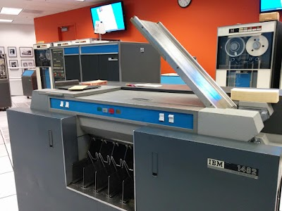 The IBM 1402 card reader/punch. The 1401 computer is in the background (left) and a tape drive is at the right.