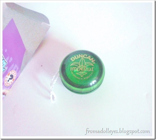 A tiny size version of a Duncan yo-yo, could it work for a doll?