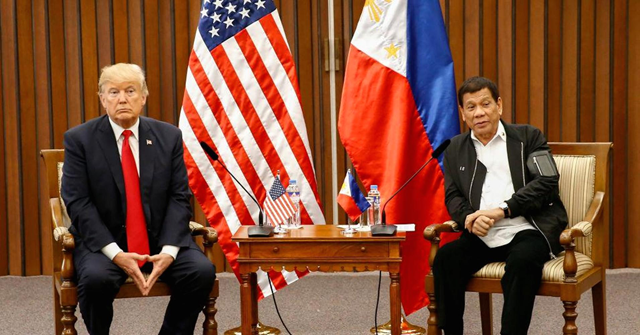 US President Donald Trump (R) speaks during a bilateral meeting with Philippine President Rodrigo Duterte on the sidelines of the 31st Association of Southeast Asian Nations (ASEAN) Summit and Related Meetings at the Philippine International Convention Center in Manila on 13 November 2017. Photo: Rolex dela Pena / AFP / Getty Images