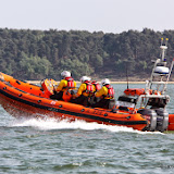 Poole Lifeboat Station's Atlantic 85 heading off to a shout on 6 June 2013 Photo: LazyBlueSkies.com
