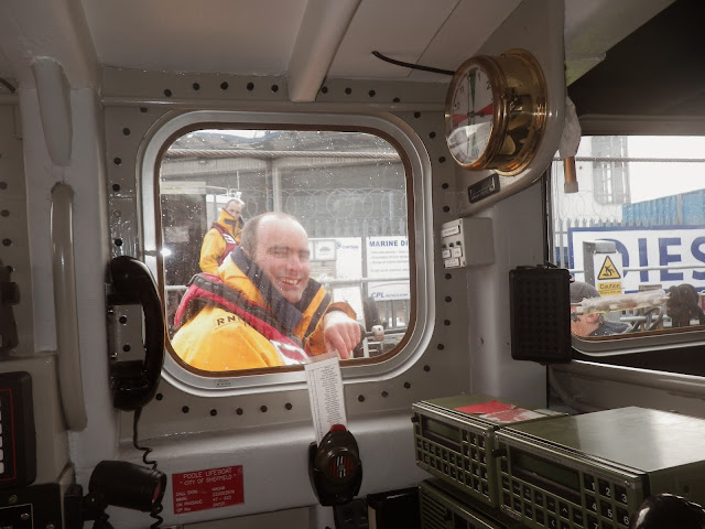 A crew member looks through the ALB window as they prepare to launch - 9 November 2013. Photo credit: Paul Taylor, RNLI/Poole