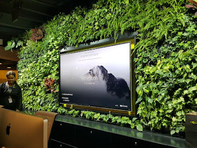A living wall greets visitors at the reception area.
