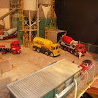 Here is a picture of a cement batching plant diorama using Bachman scalescene components + a few scratchbuilt bits. The models are all basic RTI cab chassis but The Guy tipper (GUY2) has  a scratchbuilt brass body of the type widely used by Hall and Co and the 2 mixer lorries have modified Kibri kit mixers mounted . The Foden Blue Circle bulker (FOD3) has added pipe carriers and hydraulic rams scratch built from scrap sprue.