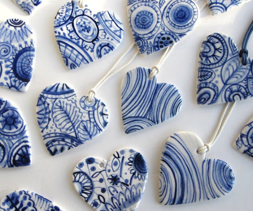Harriet Damave makes the most beautiful hand-painted pieces.  Choose one of these hearts, or one of her sweet animals. http://www.etsy.com/listing/78779450/heart-delft-handpainted-porcelain-wall