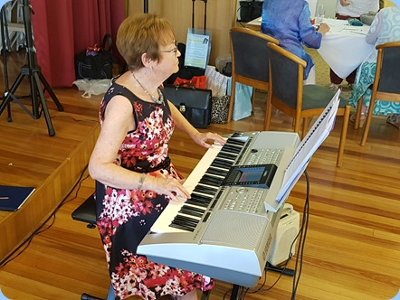 Our Events Manager, Diane Lyons, playing her Yamaha PSR3000.