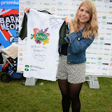 WWW.ENTSIMAGES.COM -Angela Walter with signed Tee Shirt by celebrities at       Pup Aid at Primrose Hill, London September 6th 2014Puppy Parade and fun dog show to raise awareness of the UK's cruel puppy farming trade. Pup Aid, the anti-puppy farming campaign started by TV Vet Marc Abraham, are calling on all animal lovers to contact their MP to support the debate on the sale of puppies and kittens in pet shops. Puppies & Celebrities Return To Fun Dog Show Fighting Cruel Puppy Farming Industry.                                              Photo Mobis Photos/OIC 0203 174 1069