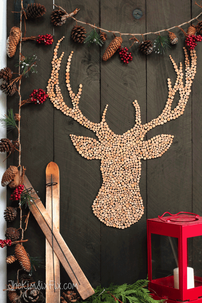Wooden front porch vignette with deer and pine cones