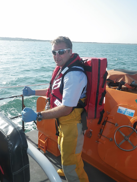 ALB Crew Member Glen Mallen wishing the first aid pack on his back was a water jet pack!  22 August 2013 Photo credit: RNLI/Paul Taylor